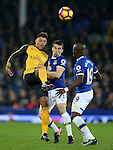 Alex Oxlade-Chamberlain of Arsenal challenged by Seamus Coleman of Everton during the English Premier League match at Goodison Park Stadium, Liverpool. Picture date: December 13th, 2016. Pic Simon Bellis/Sportimage