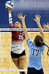 SIOUX FALLS, SD - DECEMBER 8:  Shawn Hotson #20 from the University of South Carolina Aiken tries to get a kill past the defense of Abby Palkert #17 from Palm Beach Atlantic during their quarterfinal match of the NCAA DII Volleyball Championships at the Sanford Pentagon in Sioux Falls, SD. (Photo by Dave Eggen/Inertia)