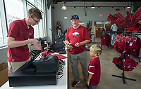 NWA Democrat-Gazette/BEN GOFF @NWABENGOFF             Austin Greek (from left), rings up a purchase for Brad Thomas, a former Arkansas defensive back, and his grandson Brady Thomas, 5, of Van Buren Wednesday, Aug. 7, 2019, at the new Hog Heaven shop on the North side of Reynolds Razorback Stadium in Fayetteville.