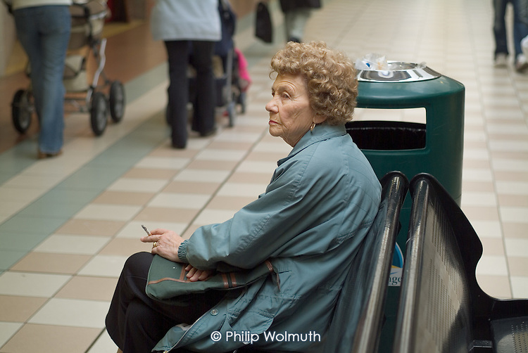 An elderly woman with a cigarette in Middleton Grange Shopping Centre, Hartlepool