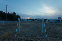 Soccer goal posts in a park in the town of Tomioka, Futaba District of Fukushima, Japan. Monday April 29th 2013. The town was evacuated on March 12th after the March 11th 2011 earthquake and tsunami cause meltdowns at the nearby Fukushima Daichi nuclear power station. It lies well within the 20 kms exclusion zone though parts of the town have recently been opened again to allow locals to visit their property during daylight hours.