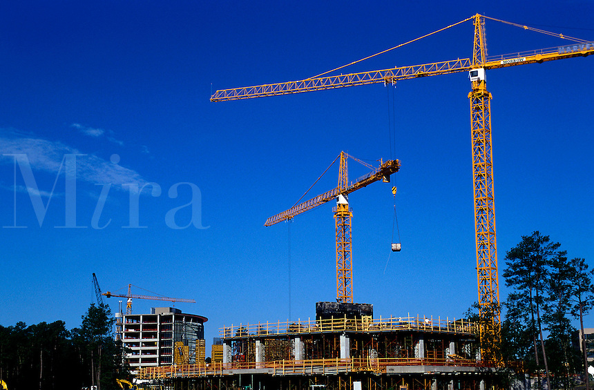 An office building construction site with cranes.