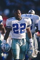 SAN DIEGO, CA - Emmitt Smith of the Dallas Cowboys walks the sidelines during a game against the San Diego Chargers at Jack Murphy Stadium in San Diego, California in 1995. Photo by Brad Mangin