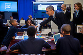 """United States President Barack Obama greets middle-school students who are participating in an """"Hour of Code"""" event in the Eisenhower Executive Office Building next to the White House in Washington, D.C., U.S., on Monday, December 8, 2014. The event is in honor of Computer Science Education Week. <br /> Credit: Andrew Harrer / Pool via CNP"""