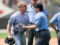 Jacksonville Suns manager Tim Leiper #11 argues a call as home plate umpire Gerard Ascani gets between him and first base umpire Sean Barber at Five County Stadium May 16, 2010, in Zebulon, North Carolina.  Photo by Brian Westerholt /  Seam Images