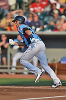 Tennessee Smokies third baseman Kris Bryant #17 runs to first during a game against the Birmingham Barons at Smokies Park on May 31, 2014 in Kodak, Tennessee. The Barons defeated the Smokies 2-1. (Tony Farlow/Four Seam Images)