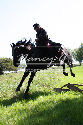A Russian Cossack riding a horse jumping