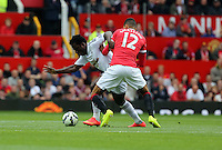 Pictured L-R: Wilfried Bony of Swansea against Chris Smalling of Manchester United. Saturday 16 August 2014<br />