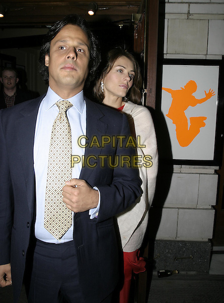 "ELIZABETH HURLEY & ARUN NAYER.Leaving the Opening Night and World Premiere of new musical ""Billy Elliot"", at the Victoria Palace Theatre, London, May 12th 2005..half length liz couple.Ref: AH.www.capitalpictures.com.sales@capitalpictures.com.©Adam Houghton/Capital Pictures."