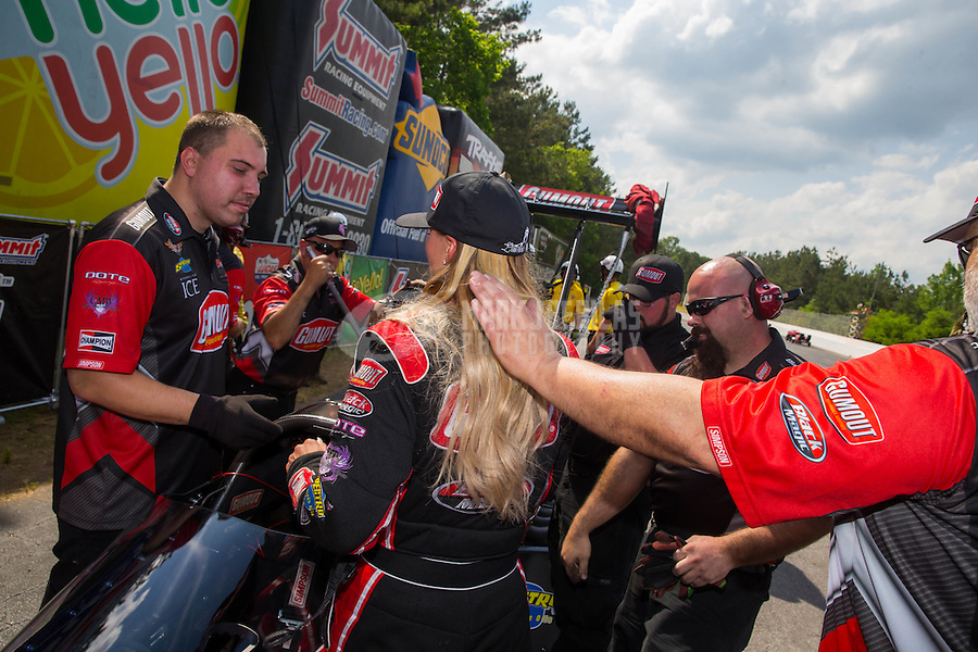 May 17, 2015; Commerce, GA, USA; NHRA top fuel driver Leah Pritchett with crew members during the Southern Nationals at Atlanta Dragway. Mandatory Credit: Mark J. Rebilas-USA TODAY Sports