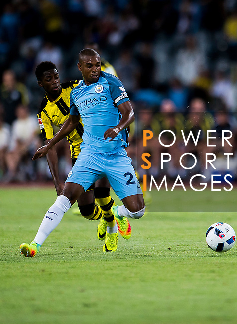 Manchester City midfielder Fernandinho Roza (r) fights for the ball with Borussia Dortmund striker Ousmane Dembele (l) during the match between Manchester City FC during their 2016 International Champions Cup China match at the Shenzhen Stadium on 28 July 2016 in Shenzhen, China. Photo by Marcio Machado / Power Sport Images
