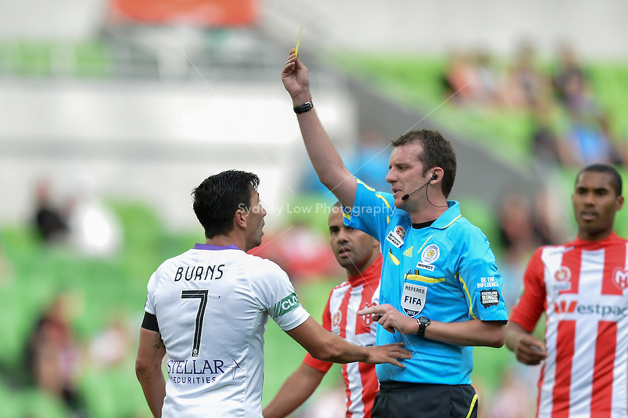 MELBOURNE - 8 DEC: Jacob BURNS of the Glory receives a yellow card in the round ten A-League match between the Melbourne Heart and Perth Glory at AAMI Park on 8 December 2012. (Photo Sydney Low/syd-low.com/Melbourne Heart)