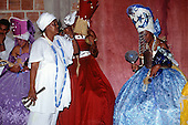 Recife, Brazil. Candomble ceremony; priests and priestesses in robes posessed by the spirits of gods; Yemanja (blue), Iansa (red)