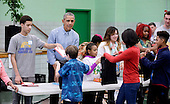 United States President Barack Obama participates in a community service project at Leckie Elementary school in celebration of the Martin Luther King, Jr. Day of Service and in honor of Dr. King's life and legacy on January 18, 2016 in Washington, DC. The President and the First Lady are participating in a community service project at Leckie Elementary School in Washington, DC in celebration of the Martin Luther King, Jr. Day of Service and in honor of Dr. King's life and legacy. The President and First Lady are joined by White House mentees as well as members of AmeriCorps in volunteering with students at Leckie, a high proportion of whom come from military families.<br /> Credit: Olivier Douliery / Pool via CNP