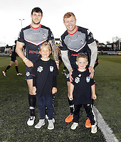 Jay Pitts and Daniel Harrison pose with two young fans during the Kingstone Press Championship game between London Broncos and Bradford Bulls at Ealing Trailfinders, Ealing, on Sun March 5, 2017
