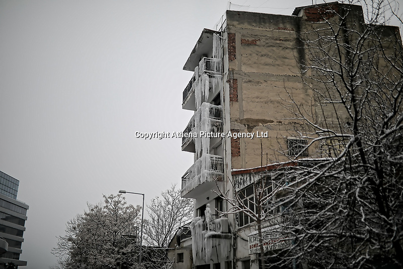Pictured: The iced over block of flats in Salonica, northern Greece. Thursday 10 January 2019<br /> Re: A fire engine had to be called to remove icicles that formed at the front of a block of flats when a water pipe on top of the building burst in the city of Salonica, northern Greece.