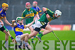 Kerry's Shane Nolan gets away from Tipperary's Cathal Barrett in the Waterford Crystal cup at Austin Stack park, Tralee on Sunday.