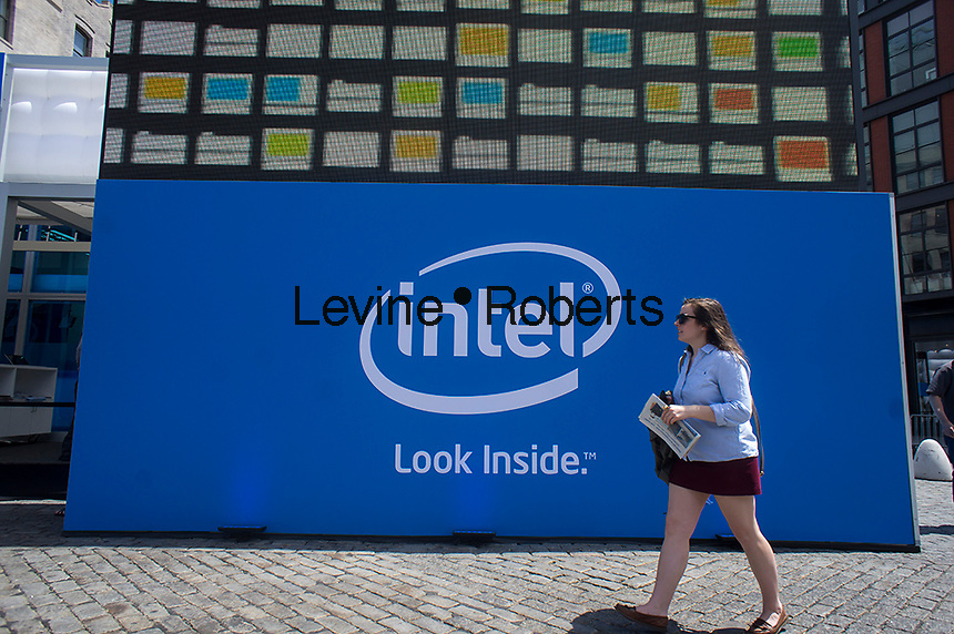 """Visitors at the Experience Intel: Look Inside pop-up """"shop"""" in the Meatpacking District in New York on Friday, May 17, 2013. The promotional event, which is part of a world tour, aims to expose consumers to various brands of computers, mostly touch screen pc's running Windows  8, all running on Intel chips. Because of tablets, smartphones and other mobile gadgets there has been a drop in sales in laptops and other personal computers. (© Richard B. Levine)"""