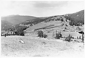 D&amp;RGW snowsheds and snow fences atop Marshall Pass, looking north by northwest from an adjacent hill.<br /> D&amp;RGW  Marshall Pass, CO  Taken by Krause, John - 9/1955