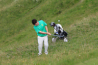 Dermot McElroy (IRL) in the rough on the 14th during the Afternoon Singles between Ireland and Wales at the Home Internationals at Royal Portrush Golf Club on Thursday 13th August 2015.<br /> Picture:  Thos Caffrey / www.golffile.ie