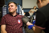 NWA Democrat-Gazette/CHARLIE KAIJO Phlebotomist Kristen Walker draws blood from Isaac Gastineau of Rogers (left) on Thursday, October 12, 2017 at Northwest Arkansas Community College in Bentonville. The Community Blood Center of the Ozarks took donations at the college's student union.