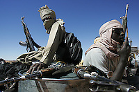 SLA ( sudan liberation army) rebels take rest after a many days of travelling in north darfur on Nov 2004
