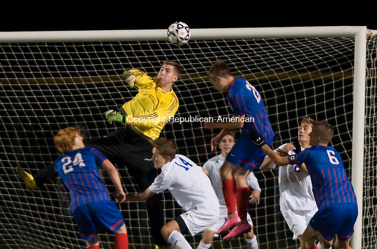 FARMINGTON, CT--- -111815JS06--Lewis Mills' goal keeper Ben Lewis makes a save during their Class M. semifinal game against Tolland Wednesday at Tunxis Mead Sports Complex in Farmington. <br /> Jim Shannon Republican-American