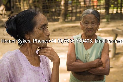 PANMYAUNG VILLAGE,  Myanmar (Burma) 2008. Three Chin tribal women with tatooed faces.