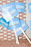 Campaign signs for Democratic presidential candidate Bernie Sanders are seen leaning against a wall before the Labor Day Parade in Milford, New Hampshire, on Mon., September 2, 2019.