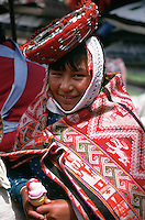 The ice-cream bought by this Indian woman in the weekly market at Pisac, which is in Peru's Sacred Valley of the Incas,  matches beautifully the traditional cloak and hat that she has donned for her outing.