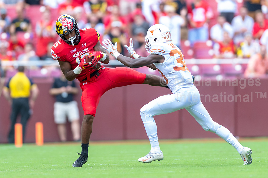 Landover, MD - September 1, 2018: Maryland Terrapins wide receiver Brian Cobbs (15) comes down with a pass over Texas Longhorns linebacker Gary Johnson (33) during game between Maryland and No. 23 ranked Texas at FedEx Field in Landover, MD. The Terrapins upset the Longhorns in back to back season openers with a 34-29 win. (Photo by Phillip Peters/Media Images International)