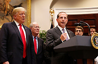 United States Secretary of Health and Human Services (HHS) Alex Azar speaks as US President Donald J. Trump looks on during the signing ceremony for S. 2553 &quot;Know the Lowest Price Act&quot; and S. 2554 &quot;Patients Right to Know Drug Prices Act&quot;, in the Roosevelt Room of the White House, Washington, DC, October 10, 2018.  Pictured between the President and Secretary Azar is US Senator Lamar Alexander (Republican of Tennessee).<br /> <br /> CAP/MPI/RS<br /> &copy;RS/MPI/Capital Pictures