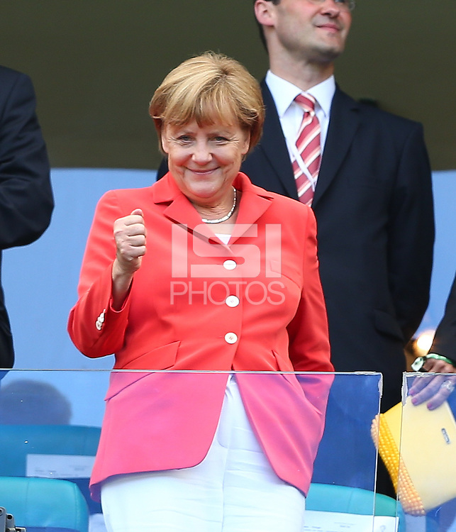 German chancellor Angela Merkel pumps her fist in the stands