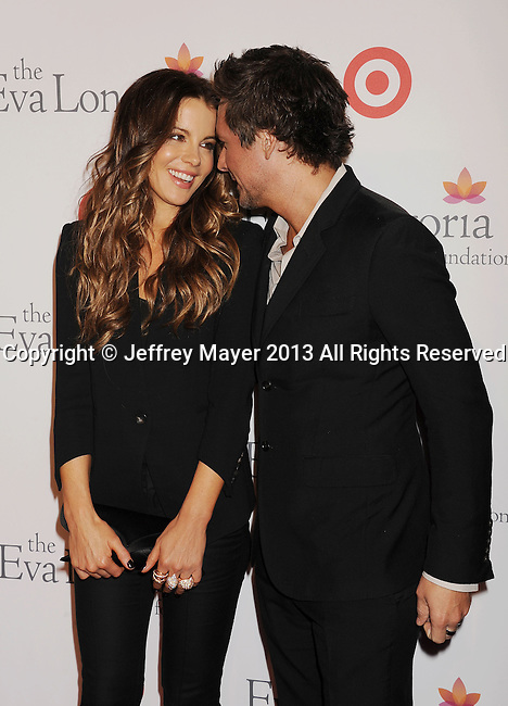 HOLLYWOOD, CA- SEPTEMBER 28: Actress Kate Beckinsale and Director/producer Len Wiseman arrive at the Eva Longoria Foundation Dinner at Beso restaurant on September 28, 2013 in Hollywood, California.
