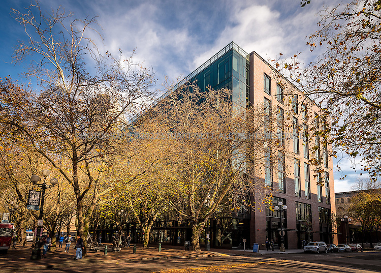 11/4/2016-- Seattle, WA, USA<br /> <br /> Weyerhaeuser&rsquo;s new Seattle headquarters in Pioneer Square, designed by architect Bill LaPatra, a partner at Mithun Architects, a firm well-known for its emphasis on sustainability.<br /> <br /> Here: Front of building looking North east.<br /> <br /> The building is unusual, because it is almost self-effacing, with the front door opening onto a park-courtyard area, with the building almost hidden behind a line of mature trees. Despite its quiet appearance, this is headquarters for Weyerhaeuser, a major corporate employer.<br /> <br /> Photograph by Stuart Isett. &copy;2016 Stuart Isett. All rights reserved.