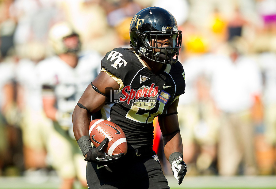 WINSTON SALEM, NC - SEPTEMBER 22: Deandre Martin (21) of the Wake Forest Demon Deacons breaks away for a 37-yard touchdown run late in the 4th quarter of play against the Army Black Knights at BB&T Field on September 22, 2012 in Winston Salem, North Carolina.  The Demon Deacons defeated the Black Knights 49-37.  (Photo by Brian Westerholt/Sports On Film)