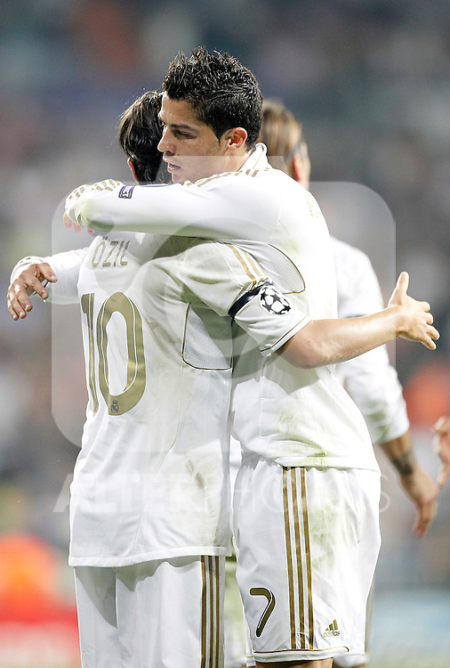 Real Madrid's Cristiano Ronaldo celebrates with Mesut Özil during UEFA Champions League match. September 27, 2011. (ALTERPHOTOS/Alvaro Hernandez)