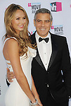 HOLLYWOOD, CA - JANUARY 12: Stacy Keibler and George Clooney arrive at the 17th Annual Critics' Choice Movie Awards at Hollywood Palladium on January 12, 2012 in Hollywood, California.