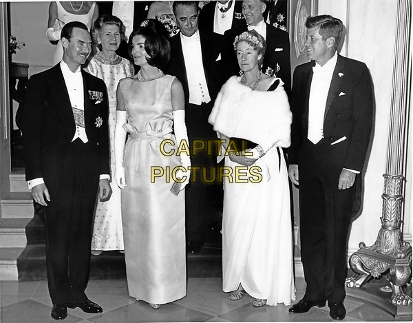 United States President John F. Kennedy, right, and first lady Jacqueline Bouvier Kennedy, left center, pose with Grand Duchess Charlotte of Luxembourg, right center, and her son Prince Jean, left, at a White House State Dinner in honor of the Grand Duchess in Washington, D.C. on April 30, 1963.  U.S. Vice President Lyndon B. Johnson is in the second row center..Credit: Arnie Sachs / CNP /MPI/Capital Pictures