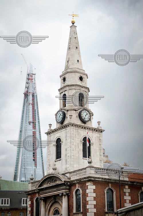 A view of The Shard, which will be the tallest building in Western Europe and is due to be completed and officially inaugurated on the 5th July 2012, opening to the public in 2013. It will contain offices, restaurants, a hotel, apartments and an observation deck. In the foreground is a church.