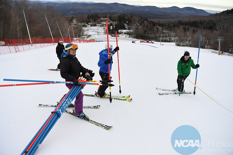 FRANCONIA, NH - MARCH 10:   Coaches and volunteers set the course prior to the Slalom event at the Division I Men's and Women's Skiing Championships held at Cannon Mountain on March 10, 2017 in Franconia, New Hampshire. (Photo by Gil Talbot/NCAA Photos via Getty Images)