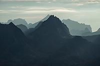 Layers of steep mountain peaks rise in the distance, Moskenesøy, Lofoten Islands, Norway
