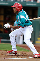 Oscar Taveras (25) of the Springfield Cardinals swings at a pitch  against the Corpus Christi Hooks at Hammons Field on August 19, 2012 in Springfield, Missouri.(Dennis Hubbard/Four Seam Images)