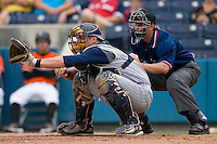 Toledo Mudhens catcher Dusty Ryan #13 gives a target as home plate umpire Rob Healy looks on at Harbor Park June 7, 2009 in Norfolk, Virginia. (Photo by Brian Westerholt / Four Seam Images)