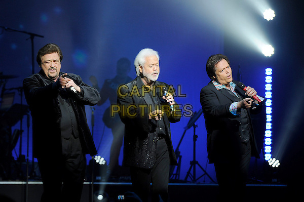 Jay Osmond, Merrill Osmond and Jimmy Osmond.performing in The Osmonds and Gareth Gates in Boogie Nights the Concert', indigo2, Greenwich, London, England, UK, 2nd March 2013..music concert on stage live brothers family half length microphone singing black shirt jacket  brothers family .CAP/MAR.© Martin Harris/Capital Pictures.