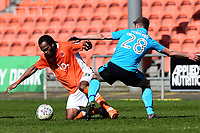Blackpool's Nathan Delfouneso vies for possession with Fleetwood Town's Jack Sowerby<br /> <br /> Photographer Richard Martin-Roberts/CameraSport<br /> <br /> The EFL Sky Bet League One - Blackpool v Fleetwood Town - Saturday 14th April 2018 - Bloomfield Road - Blackpool<br /> <br /> World Copyright &not;&copy; 2018 CameraSport. All rights reserved. 43 Linden Ave. Countesthorpe. Leicester. England. LE8 5PG - Tel: +44 (0) 116 277 4147 - admin@camerasport.com - www.camerasport.com