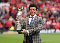 Pictured: Golfer Rory McIlroy with his trophy. Saturday 16 August 2014<br />
