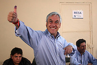 Sebastian Pinera, presidential candidate of Chile's opposition coalition, casts his ballot in a polling station of Santiago during the country's general elections , Sunday, Dec. 13, 2009. Pinera, a right-wing billionaire, beat three leftists but will have to face a runoff against ruling coalition candidate Eduardo Frei , the second in the presidential race.