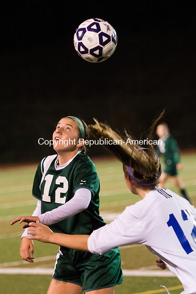 MIDDLETOWN, CT - 16 November 2015-111615EC03-- Holy Cross' Hayley Gilmore heads the ball in front of Old Lyme's Mya Johnson in Middletown Monday night. Erin Covey Republican-American.
