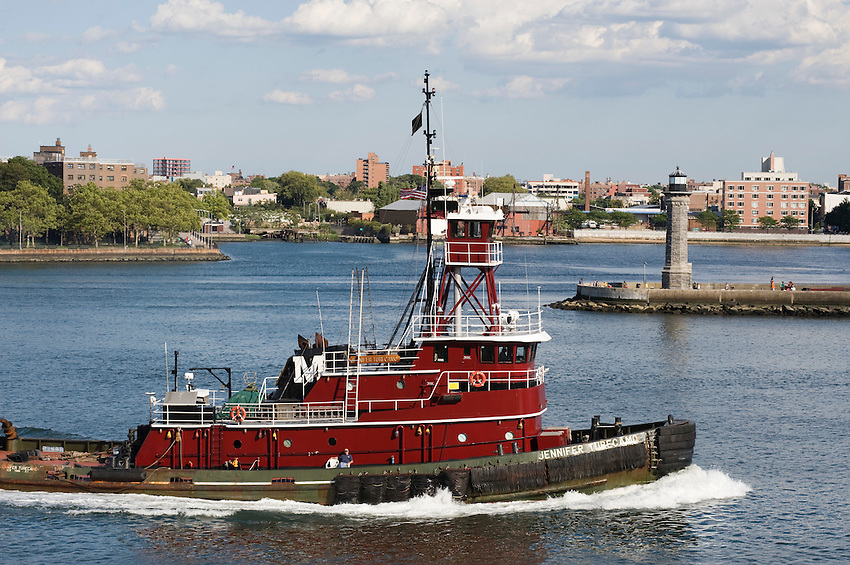 Moran Towing Corp.'s tugboat Jennifer Turecamo cruises down the East River in New York City.
